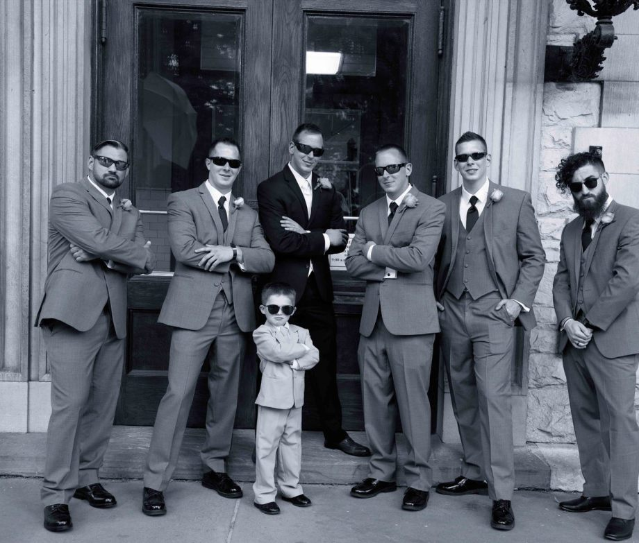 grooms men with sunglass looking at camera